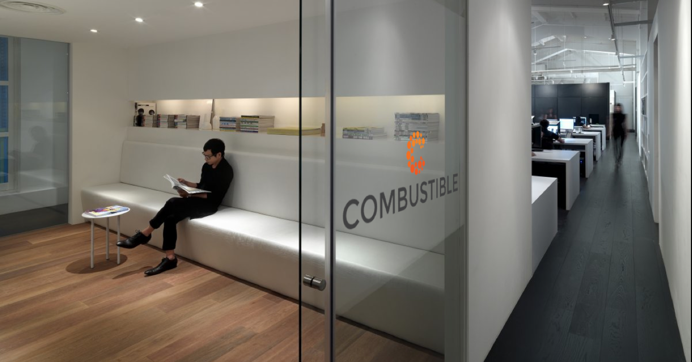 combustible marketing agency SEO logo design on glass wall