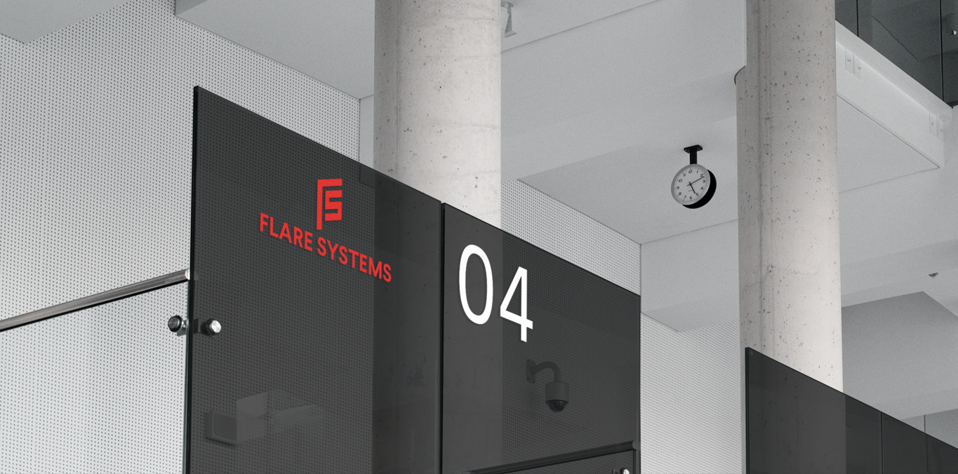flare systems logo visual identity on a glass wall